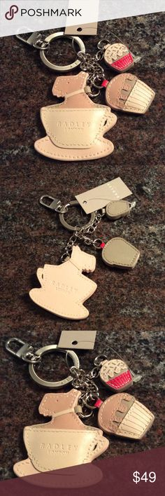 Radley of London key chain or purse charm Super cute! Radley of London key chain with charms or can be used as a purse charm.  Hard to find! Genuine leather.  Radley in a tea cup with two cupcake charms. Radley of London Accessories Key & Card Holders