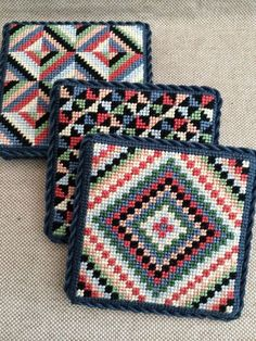 Needlepoint quilt coasters ~ canvases by Susan Roberts Plastic Canvas Stitches, Plastic Canvas Coasters, Plastic Canvas Crafts, Plastic Canvas Patterns, Cross Stitch Embroidery, Embroidery Patterns, Hand Embroidery, Cross Stitch Patterns, Quilted Coasters