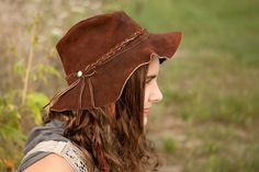 Leather, floppy-brimmed, hippy hat - I had one exactly like this many decades ago!