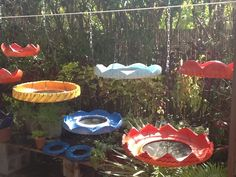 Recycled Tire Bird Feeders by cooltireswings.com