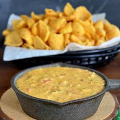 Chicken Fajita Queso Dip      2 Tablespoons olive oil     1/2 cup diced green pepper     1/4 cup diced onion     1 cup finely chopped cooked chicken     3 Tablespoons fajita seasoning mix     1 pound Velveeta cheese, cubed (16 oz.)     1 can Ro*Tel diced tomatoes with green chilies (10 oz. undrained)