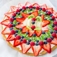 Fruit Pizza with Cream Cheese Frosting Recipe! Easy to make, Gorgeous and SUPER Yummy! Fresh Berries, Kiwi, Peaches on a giant frosted cookie! YUM! #Fruit #Pizza #Cream_Cheese #Frosting #Recipes #Colorful #Easy #Food