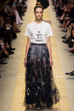 Dior Spring 2017: Model walks the runway in 'We Should All Be Feminist' shirt and embroidered maxi skirt