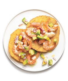 Shrimp and Avocado Tostadas|Dress up fried corn tortillas with juicy shrimp, avocados, red onion, and a splash of lime juice to add a tart brightness.