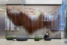 Product Selector > Deloitte Canadian Headquarters by Eventscape Inc. Partition Design, Facade Design, Wall Partition, Screen Design, Wall Design, A As Architecture, Architecture Interiors, Globe Lamps, Lobby Design