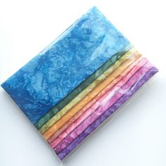QuiltyBox July 2016 - check out the latest Quilty Box with rainbow batik fabric and two quilt patterns to try