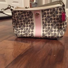 Grey leather coach bag with coin purse Great little bag. Looks brand new. No signs of wear. The little coin purse has some pink discoloration around the seams but it doesn't draw away from the look. Coach Bags