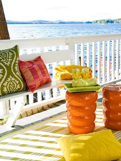 Who wouldn't want to relax on this colorful deck? See more ideas for deck decor: http://www.bhg.com/home-improvement/deck/ideas/deck-decor-ideas/?socsrc=bhgpin081212colorfulbeachpatio#page=4