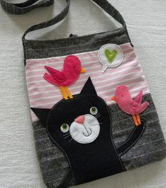 The link is to a picture with no tutorial (that I can see). But how cute is this cat with these birds?? Totally adorable and easy to do!!