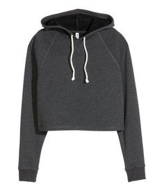 Short top in soft sweatshirt fabric with a drawstring hood and long raglan sleeves with ribbed cuffs. Soft, brushed inside.