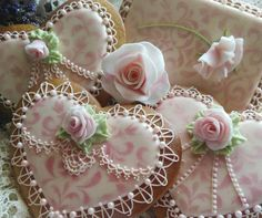 Sheer romance Valentine cookies - hearts with dry-brush stenciled pink swirls, delicate RI piped lace, pink fondant roses - by Teri Pringle Wood