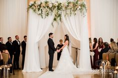 Adding a touch of floral and drapery design to your wedding ceremony can make all the difference like in this summer saratoga wedding