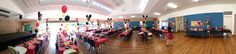 Panoramic shot of a gorgeous Mickey Mouse themed birthday party in large parish hall
