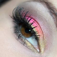 This pink eye makeup is enhanced using a gold eye shadow as a liner and highlight. Create this with long eyelashes to make your brown eyes pop!