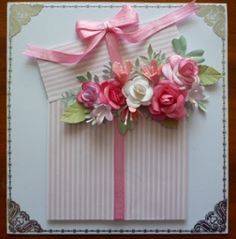 "Easy, beautiful card. Cut apart a square, offset the top, ""tie"" with ribbon and fill with flowers and leaves."