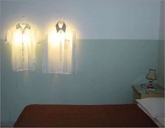 lighting fixtures AND clothes hanger. Yeap, saving spaces!