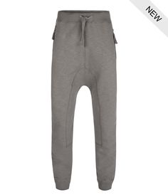 A dropped crotch, heavy weight, sweat pant. Made in a slub cotton brush back fleece. Featuring exposed tape zip pockets, shaped panel inserts with cover-stitching on the inside and back leg. Detailed with a patch pocket. Finished with woven drawcords, a ribbed waistband, ankle cuffs and a new metal stud branding with leather washer.