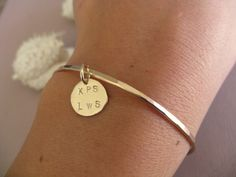 Gold Bangle Bracelet - Hammered and Personalized with Gold Circle Charm. $45.00, via Etsy.