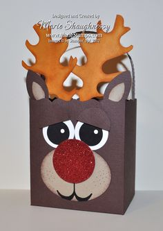 Rudolph the Reindeer Fancy Favor Box from MarieStamps.com.  This bag features Stampin' Up!'s Fancy Favor and Autumn Accents Dies.  Visit my blog to see how I did the antlers for this cute punch art project!
