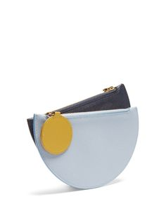 Roksanda takes the same approach to its accessory designs as it does its lauded ready-to-wear – think clean lines and bold, contrasting colours. This Dual coin purse features two semi-circle shaped compartments in navy and pastel-blue shades, each one securing with a pistachio-green circle zip pull. It's a very modern way of storing your loose change.