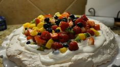 Pavlova, it is a meringue-based dessert that has a lovely crisp shelled crust with a chewy and tender inside, then is topped with freshly whipped cream and fresh fruit. This dessert is as gorgeous as it is delicious and best of all, it looks so complex and impressive, you'd think it's incredibly hard to make, but no, it is quite simple and made with very few ingredients that I bet you have on hand. Dessert Names, Anna Pavlova, Shelled, Stuffed Shells, Few Ingredients, Meringue, Whipped Cream, Fresh Fruit, Crisp
