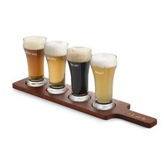 Give the gift that keeps on giving with a craft beer flight set! This set of    four, 6 oz. personalized beer glasses sit on a wooden board for flight tasting  at it's finest. Personalize the glasses, the paddle handle or the back of the   board to create the perfect personalized gift for beer lovers!<br><br>-A great  personalized birthday, groomsmen or wedding gift<br>-Dishwasher safe<br>-Each   engraved Pilsner glass holds 6 oz.