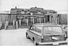 "The Oak Beach Inn in Oak Beach. Notice the car in the parking lot has a ""Save the Oak Beach Inn"" bumper sticker on its rear bumper. (Aug. 15, 1980)"