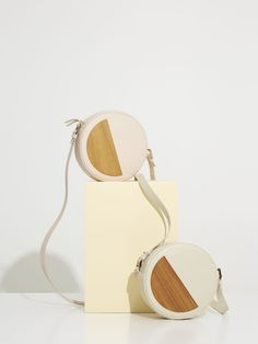 Rohe Bag by Bakari. Structured bag with round shape made of calf leather and decorated with an inserted semicircular piece of Spanish walnut wood. Cotton lining. Handmade in Spain. Structured Bag, Walnut Wood, Summer 2016, Calf Leather, Shoulder Strap, Spanish, Shapes, Spring, Cotton