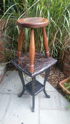 Three legged bullseye stool & floral carved side table.