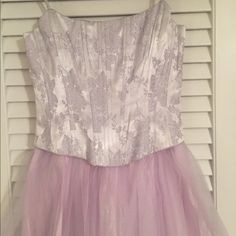 Formal gown Gorgeous princess prom dress. So beautiful. Fit for a prom queen for sure. No size tag but will fit a size 4. Gorgeous shades of lilac and silver. Dresses Prom