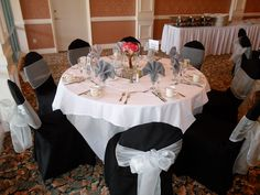 Black Chair Covers available for rent with Silver Organza Bows in Upland  - Special Event Linens
