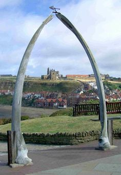 Whalebone Arches in Whitby, North Yorkshire, England. In the background is Whitby Abbey.
