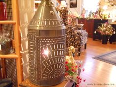 Large punched tin floor lantern, really make a statement in your country room.