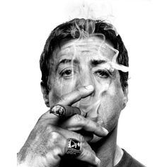 "sylvester stallone. ""This picture of Sylvester Stallone was done in a Hollywood studio, he is one of those iconic figures that transcends any single movie or project. It took me a while to break through the brand and reach the man, but once that barrier had broken, the cigar came out. In this case perhaps, all of his legendary performances, all his legendary characters built on defiance are embedded in this picture. I never seek to build a personalized friendship with any of my sitters after…"