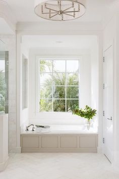 tub molding and placement in front of window / MASTER BATH Neutral Bathroom Floor Tile Floor tile is Mystery White Marble honed cut Herringbone Pattern source on Home Bunch Bad Inspiration, Decoration Inspiration, Bathroom Inspiration, Bathroom Ideas, 1950s Bathroom, Parisian Bathroom, Bathroom Goals, Decor Ideas, Interior Inspiration