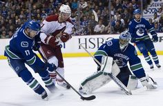 Goalie Roberto Luongo of the Vancouver Canucks watches Ryan Kesler clear the puck before getting checked by Martin Hanzal of the Phoenix Coyotes Ryan Kesler, Phoenix Coyotes, Vancouver Canucks, Nhl, Hockey, Watches, Clocks, Clock, Field Hockey