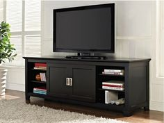 """70"""" Wide Black Wood TV Console-Easy to Assemble with Sliding Doors"""