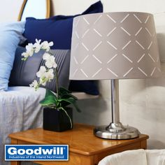 We found this amazing silver lamp base with this stunning lampshade that looks brand new for only $5.99! Light up any room with finds at Goodwill.