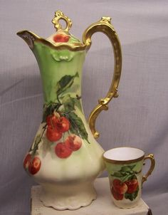 FOR SALE LEGRAND LIMOGES HAND PAINTED CHOCOLATE POT AND CUP. FREE OF CHIPS OR CRACKS, NO LOSS OF GOLD IT IS 10-1/2 TALL IT IS STAMPED WITH LEGRAND MARK THAT WAS USED IN THE 1920's. SIGNED FIBLET IN