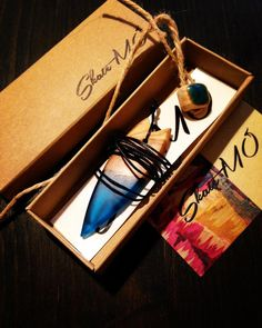 Surf necklaces made by skateboard decks or different types of stabilized wood