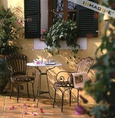cafe...I have been looking for a bistro set for a year now!!!! i LOVE this!
