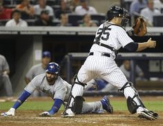 GAME 89: Monday, July 16, 2012 - Toronto Blue Jays' Jose Bautista, left, slides home past New York Yankees catcher Russell Martin during the sixth inning of the baseball game at Yankee Stadium in New York. (AP Photo/Seth Wenig).