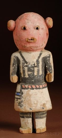 """Southwest Polychrome Carved Wood Kachina, Hopi, c. 1900, with mud-head mask and arms carved away from the sides, (wood loss), old tag reads """"from Indian Trading Post, Petty and Chapman,"""" """"Hopi Katchina,"""" and """"Mud Katchina Clown"""" on the reverse, ht. 8 3/4 in."""