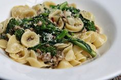 """In Italy, broccoli rabe is also known as rapini and cime di rapa. It has a slightly bitter flavor that nicely compliments the Italian sausage and orecchiette pasta. The little """"bowls"""" of the orecch. Broccoli Rabe And Sausage, Broccoli Rabe Recipe, Pasta Con Broccoli, Italian Pasta, Italian Dishes, Italian Recipes, Italian Foods, Italian Cooking, Gnocchi"""