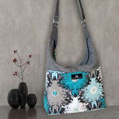 This intermediate level PDF sewing pattern for the Snazzy Slouch bag by Chris W Designs comes with 33 pages of complete instructions which also include over 70