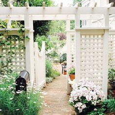 Love this - staggered panels with landscaping between and around to form a fence like enclosure without it being a fence.