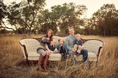Rustic country setting, sofa in nature. Family of five.