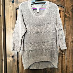 Kenar long sweater Oh my...how to describe this beauty. Scooped hem in front. Three quarter sleeves. Light weight open knit (need tank underneath bc see through). Excellent condition. Kenar Sweaters Crew & Scoop Necks