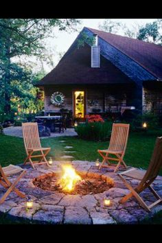 Stones around the fire pit add stability to chairs and surface for candles or beverages