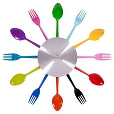 I love this, so cute for kitchen with the bright colors. Wall clock with multicolor flatware detail. Product: Wall clockConstruction Material: MetalColor: MultiDimensions: DiameterCleaning and Care: Wipe with damp cloth Plastic Silverware, Cute Kitchen, Kitchen Ideas, Awesome Kitchen, Kitchen Inspiration, Kitchen Upgrades, Kitchen Gadgets, Kitchen Decor, Design Inspiration